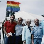 Jess Jessop (second to left) outside Lesbian and Gay Archives tent at Pride