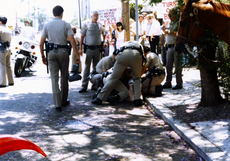 Police officers restraining Brian Barlow, 1986