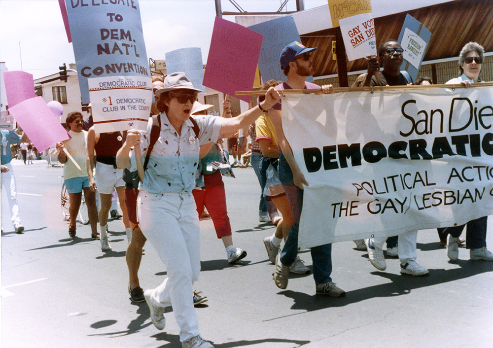Jeri Dilno in Pride parade with sign for San Diego Democratic Club, 1988