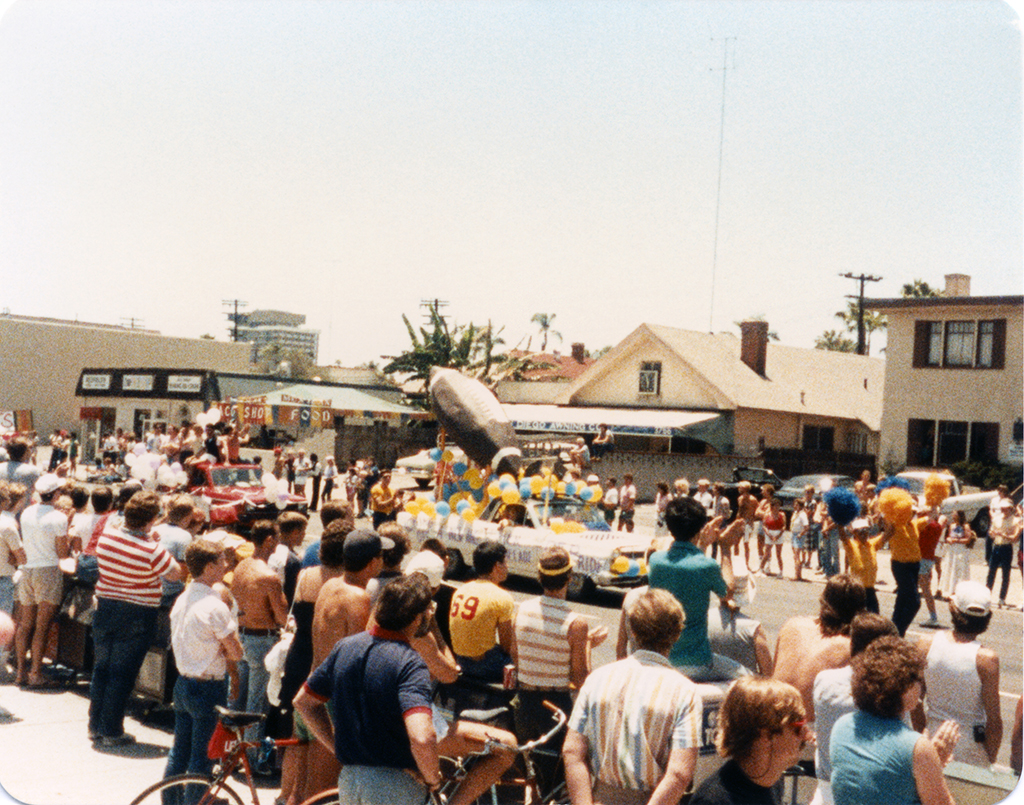 Spectators watching parade floats, 1984