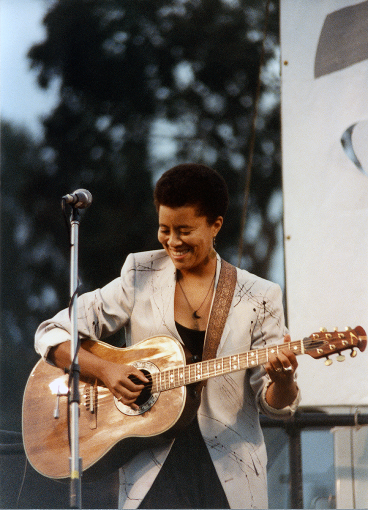 Deidre McCalla playing guitar at Pride Festival, 1989