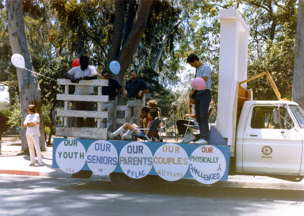 Parade participants relaxing on the Grand Marshals float, 1985
