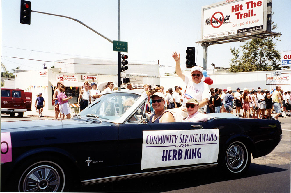 Community Service Award recipient Herb King rides in the parade, 1996