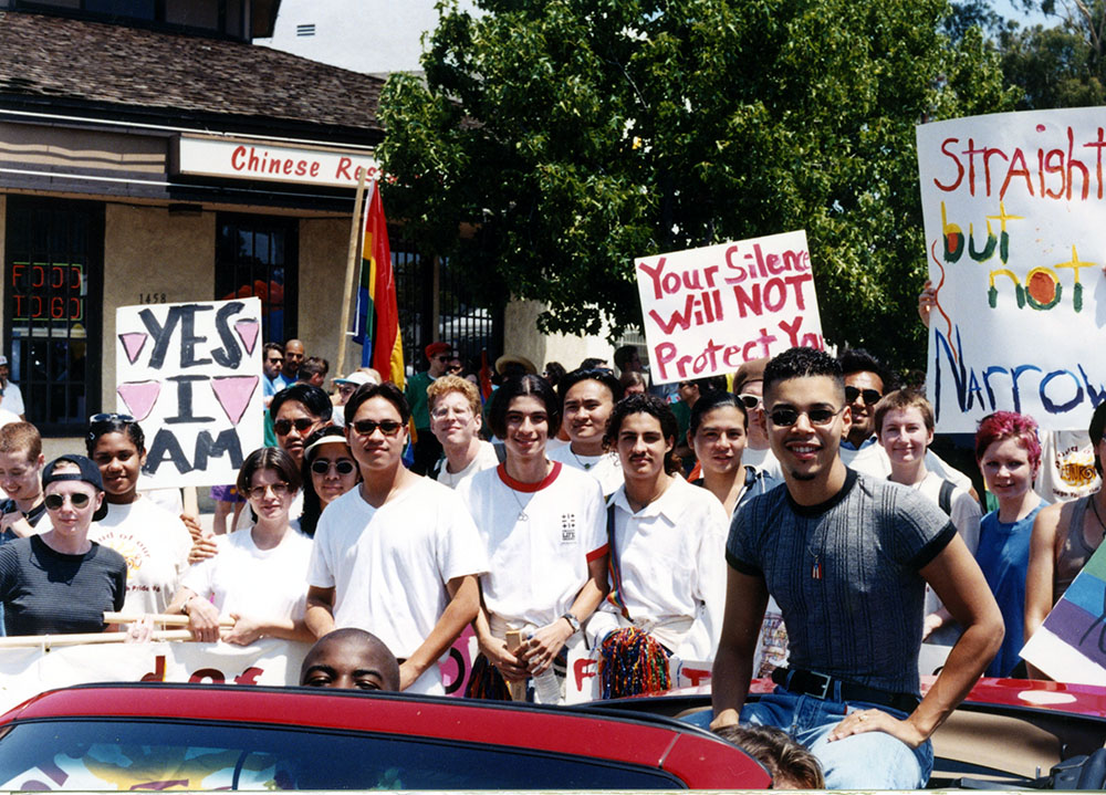 Grand Marshal Wilson Cruz with crowd in the parade, 1996